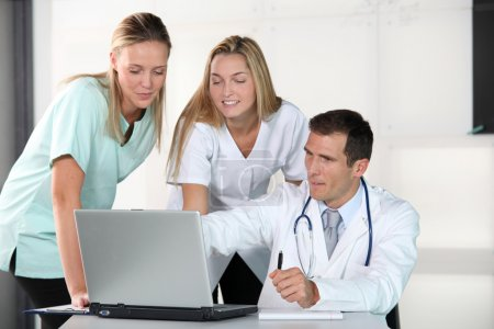 Closeup of doctor and nurses in the office