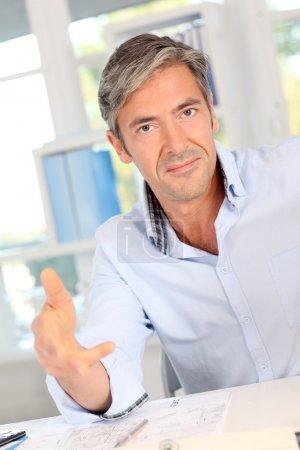 Businessman giving arguments to client