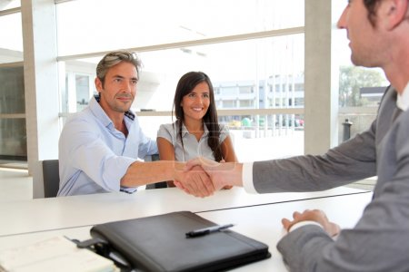 Photo for Man giving handshake to real-estate-agent - Royalty Free Image