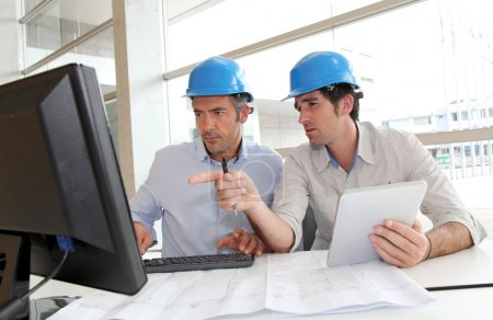 Photo for Architects working on construction plan - Royalty Free Image