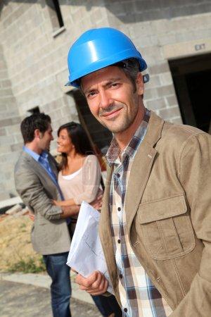 Portrait of smiling entrepreneur standing on construction site