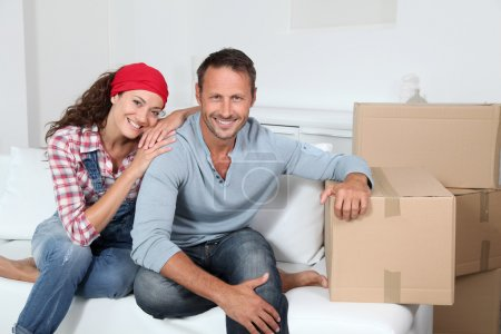 Photo for Couple moving in new house - Royalty Free Image