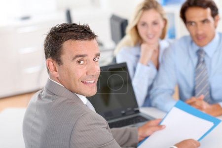 Photo for Couple with real-estate agent in office - Royalty Free Image