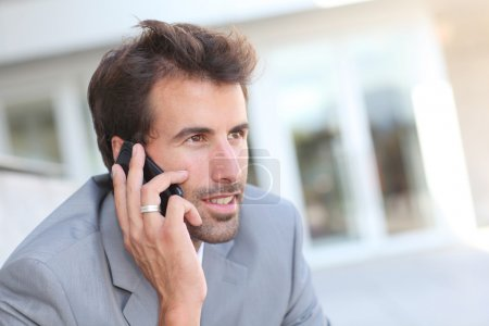 Portrait of businessman talking on the phone