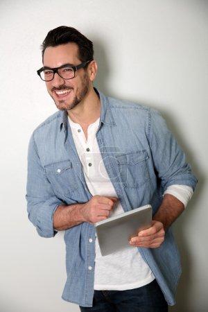 Man with eyeglasses using digital tablet
