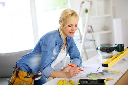 Woman working on home improvement planning