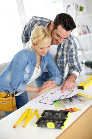Couple designing home interior project