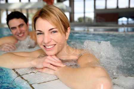 Portrait of woman with husband in jacuzzi