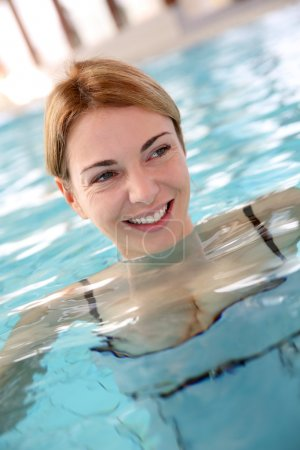 Woman in spa center swimming-pool