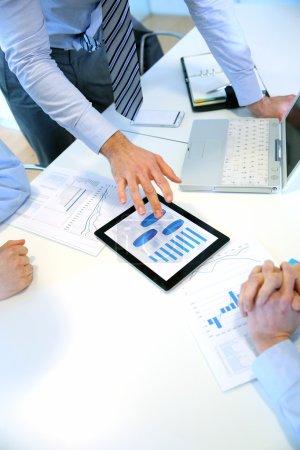 Closeup of tablet screen presenting charts