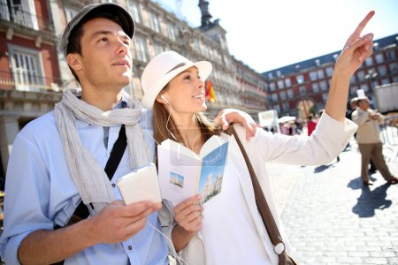 Photo for Tourists walking in La Plaza Mayor with traveler guide - Royalty Free Image