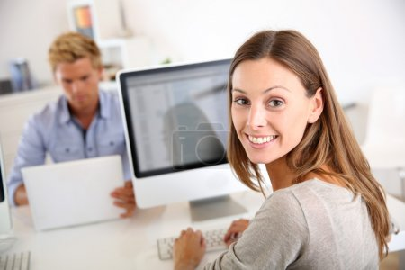 Office worker in front of desktop