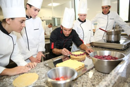 Photo for Students with teacher in pastry training course - Royalty Free Image