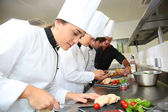 Chefs preparing delicatessen dishes