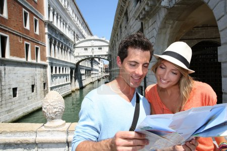 Couple looking at map by the Bridge of Sighs