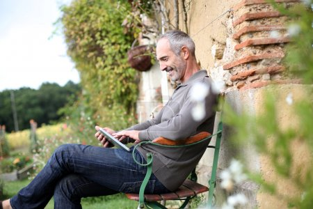 Man relaxing in country house