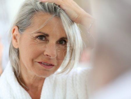 Woman worried by hair getting grey