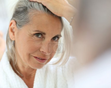 Woman worried by hair getting grey