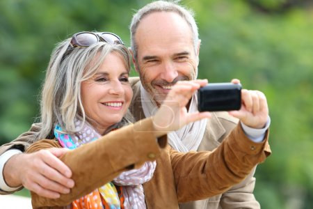Senior couple taking picture