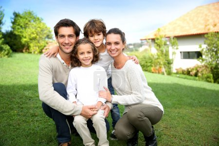 Photo for Smiling family portrait of 4 people - Royalty Free Image