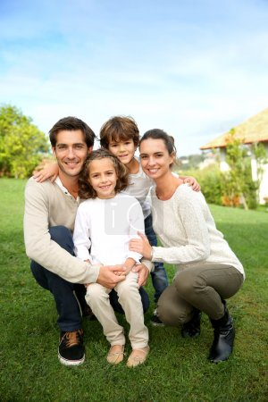 Photo for Cute family portrait of 4 people - Royalty Free Image