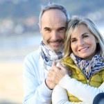 Portrait of smiling senior couple...