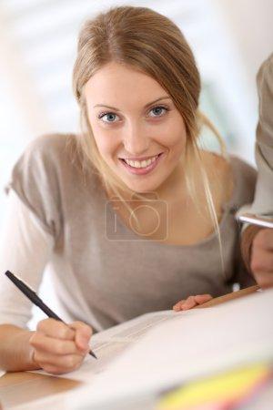 Girl filling application form