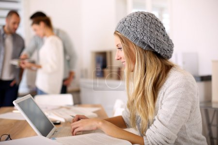 Student girl working on laptop