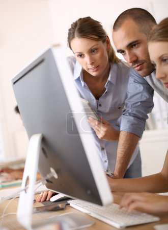 Businesspeople working on computer
