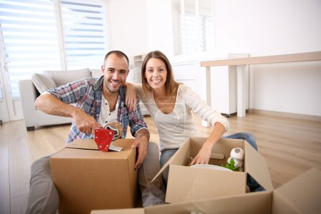 Photo for Smiling couple moving in new home - Royalty Free Image