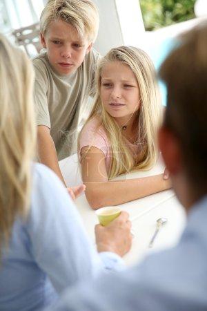 Kids listening to their parents