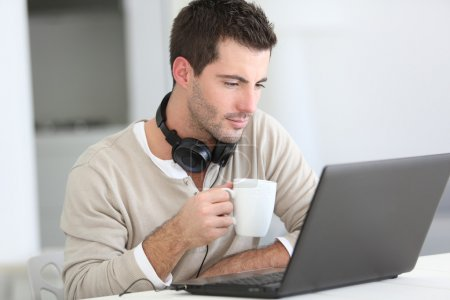 Man in front of laptop computer