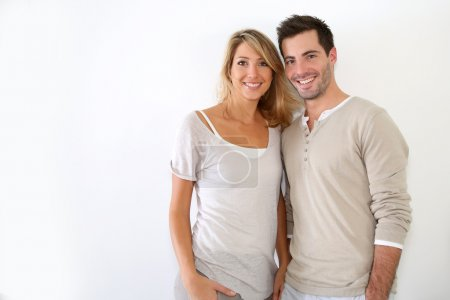 Photo for Cheerful couple standing on white background - Royalty Free Image