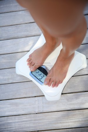 Woman check on weight