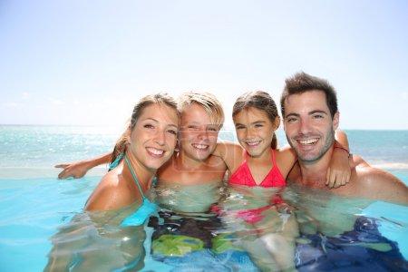 Happy family enjoying bath time
