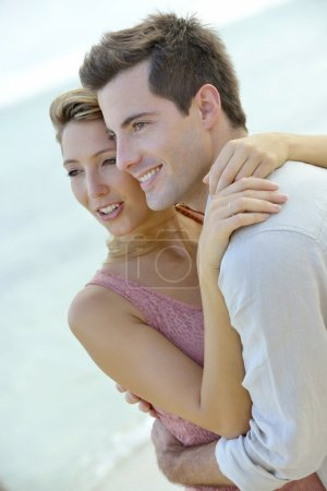 Couple embracing by the beach