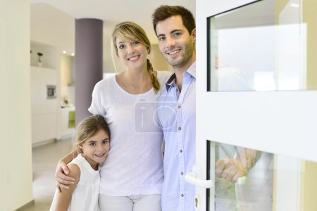 Family standing at front door