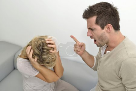 Photo for Man being angry at woman and using violence - Royalty Free Image