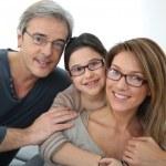 Portrait of family of 3 people wearing eyeglasses...