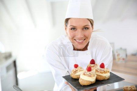 Pastry chef showing desserts