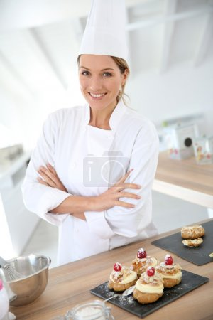Confectioner in professional kitchen