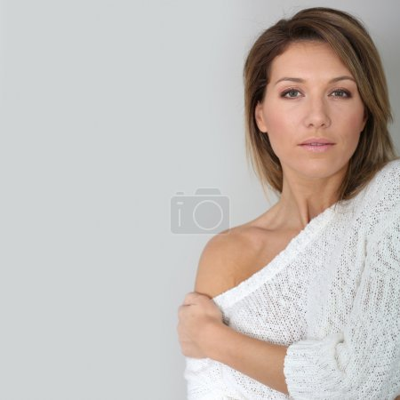 Woman with hand on shoulder
