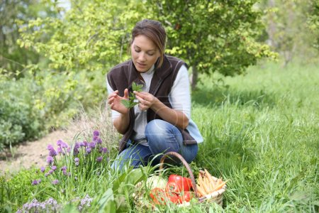 Woman smelling aromatic herbs
