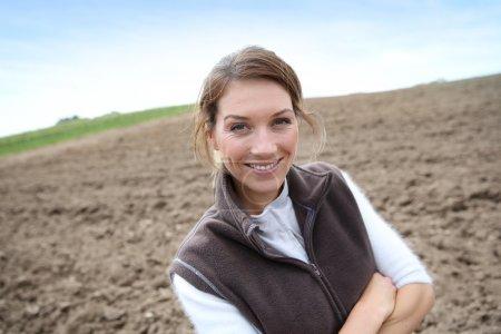 Woman standing on farming land
