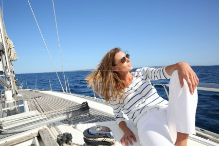 Photo for Attractive modern woman enjoying sailing cruise - Royalty Free Image