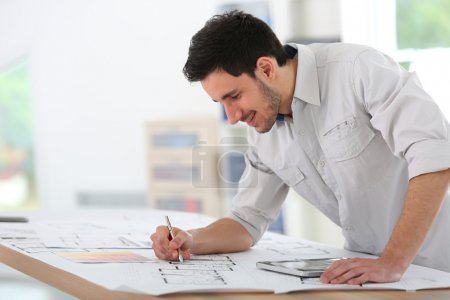 Architect drawing construction blueprint