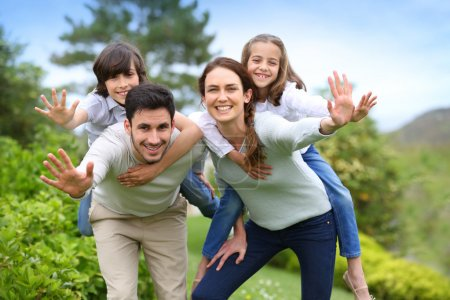 Photo for Happy family having fun in home garden, waving by hands - Royalty Free Image