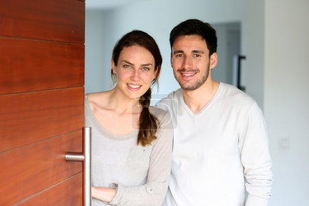 Couple opening door