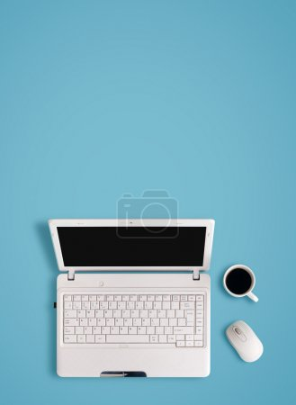 Photo for White laptop on table - place for text. - Royalty Free Image