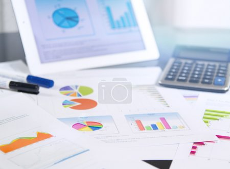 Photo for Bunch of business documents - charts and graphs on the desktop - Royalty Free Image